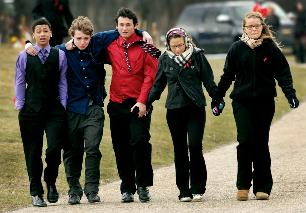 Chardon High School students walk away after a funeral for one of their classmates killed in a school shooting